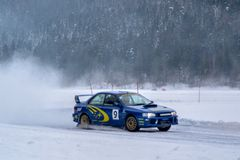 Drifting. Ice Car sport motorcross vehicle track speed action fun Winter Snow Cold police Subaru Royalty Free Stock Image