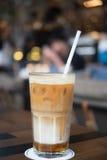 Ice caramel macchiato. Focus of ice caramel macchiato in coffee shop area, selective focus stock photo