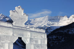 Ice carving in Canadian Rockies. Maple leaf on an ice castle at Lake Louise in the Canadian Rockies, with Mount Victoria behind royalty free stock images
