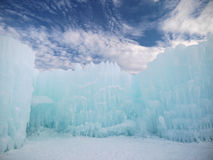 Ice Castle and Sky in New Hampshire. On a crisp winter day, various hues of blue from sky and ice are found in a surreal surrounds stock image