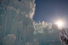 Ice castle. Sunburst blue sky. Winter weather stock photos