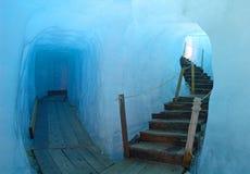 Ice cave. Footbridge inside the ice cave (Eisgrotte am Rhonegletscher) on Furka Pass, Alps, Valais, Switzerland Stock Photography
