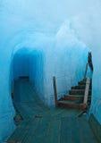 Ice cave. Footbridge inside the ice cave (Eisgrotte am Rhonegletscher) on Furka Pass, Alps, Valais, Switzerland Stock Photos