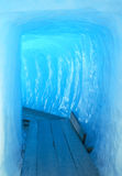 Ice cave. Footbridge inside the ice cave (Eisgrotte am Rhonegletscher) on Furka Pass, Alps, Valais, Switzerland royalty free stock image