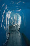 Ice cave. Footbridge inside the ice cave (Eisgrotte am Rhonegletscher) on Furka Pass Royalty Free Stock Photos