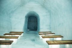 Ice Cave Church. With wooden benches stock photos