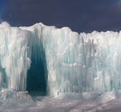 Ice Cave Entrance Against A Blue Sky stock image