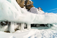 Ice cave with icicles at the mountain in Lake Baikal Royalty Free Stock Photos