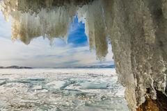Ice Cave with icicles, winter Lake Baikal. Russia Stock Image