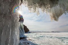 Ice Cave with icicles, winter Lake Baikal. Russia Stock Photo