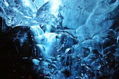 Ice cave's ice. Shading of ice in ice cave from above to the bottom, light blue to dark blue Stock Photo
