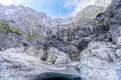 Ice cave under glacier in Alps mountains near Koenigssee, Konigsee, Berchtesgaden National Park, Bavaria, Germany.  royalty free stock image