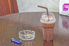 Ice chocolate and Cigarette on a table. In coffee shop Royalty Free Stock Photography