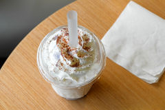 Ice chocolate frappe and whipped cream in the takeaway plastic cup Royalty Free Stock Photography