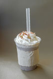Ice chocolate frappe and whipped cream in the takeaway plastic cup Stock Images