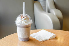 Ice chocolate frappe and whipped cream in the takeaway plastic cup Stock Image