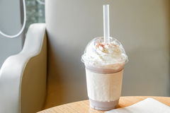 Ice chocolate frappe and whipped cream in the takeaway plastic cup Royalty Free Stock Image