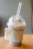 Ice chocolate frappe and whipped cream in the takeaway plastic cup Royalty Free Stock Photo