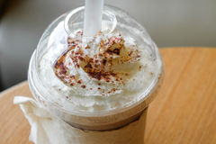 Ice chocolate frappe and whipped cream in the takeaway plastic cup Royalty Free Stock Images