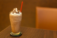 Ice chocolate with whipped cream on table Royalty Free Stock Photo