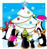 Ice Christmas. A family of penguins decorating a snow and ice tree Stock Images