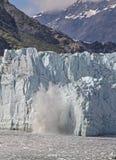 Ice Chunk Falls into Water at Glacier Bay National Park, Alaska Stock Images