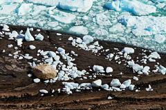 Ice Chunks on the Edge of a Frozen Lake. Ice chunks are bright blue in color from a glacier Royalty Free Stock Photos