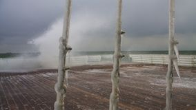 Ice-clad cables against stormy sea royalty free stock image