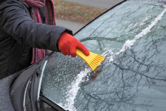 Ice cleaning from windshield Royalty Free Stock Photography