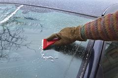Ice cleaning from windshield Stock Photo