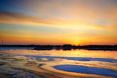 The ice clearing and sunset glow Royalty Free Stock Photos