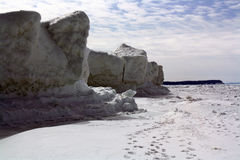 Ice Cliff. An ice cliff jetting out against the sky on Lake Michigan Stock Image