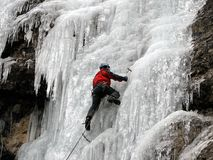 Ice climber. Young man, ice climbing an attractive route Stock Image