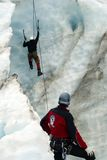 Ice climber 2. An ice climber being watched over by instructor, Fox glacier, NZ royalty free stock photos