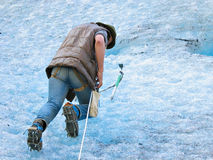 Ice climber. With ice-axe Stock Images