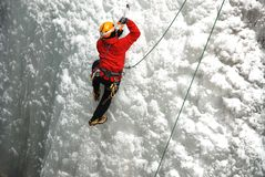 Ice Climber. An Ice Climber going up a frozen waterfall Stock Photography