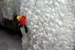 Ice Climber. An Ice Climber going up a frozen waterfall Royalty Free Stock Image