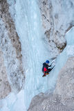 Ice climber in an ice fall. Ice climber soloing in a steep ice fall Stock Photos