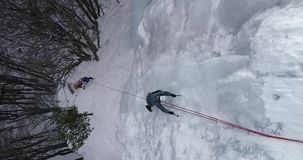 Ice Climbing Frozen Waterfall.