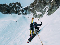 Ice climbing: mountaineer on a mixed route of snow and rock duri Royalty Free Stock Photography