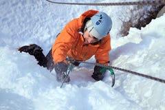 Ice climbing the North Caucasus. Man climbing frozen waterfall.Ice climbing the North Caucasus Stock Photos