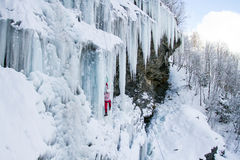 Ice climbing the North Caucasus. Man climbing frozen waterfall Stock Images
