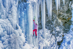 Ice climbing the North Caucasus. Ice climbing the North Caucasus, man climbing frozen waterfall Royalty Free Stock Photos