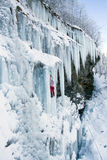 Ice climbing the waterfall. Royalty Free Stock Photography