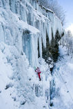 Ice climbing the waterfall. Royalty Free Stock Photo