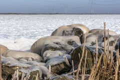 Ice on the coast at on a rock stock photography