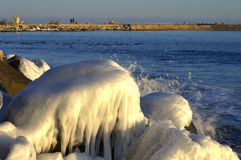 Ice coastal rocks Stock Image