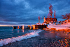 Ice Coated Breakwalls at Point Betsie Lighthouse in Michigan Stock Image