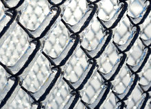 Ice coated chain link fence from an ice storm Royalty Free Stock Photo