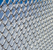 Ice coated chain link fence from an ice storm Royalty Free Stock Image